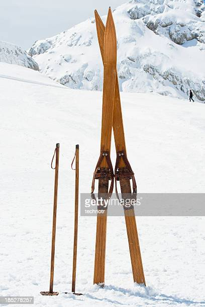 Retro ski equipment against the mountain