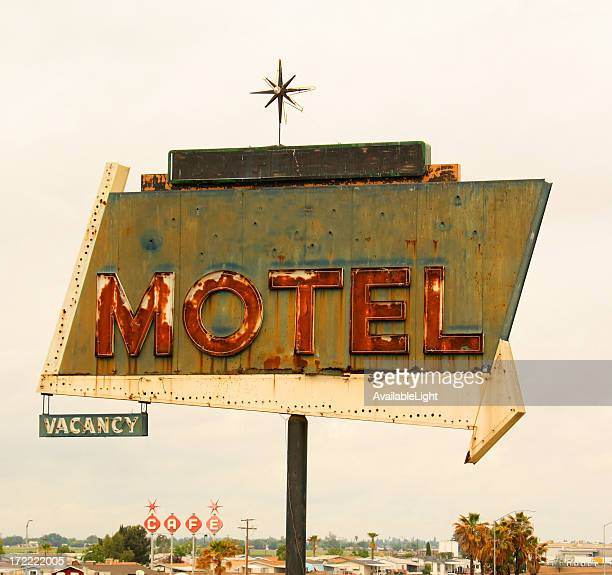 Retro style motel sign with arrow