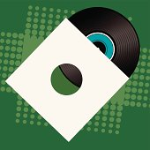 Retro style record and sleave place over a green background with half tone dot