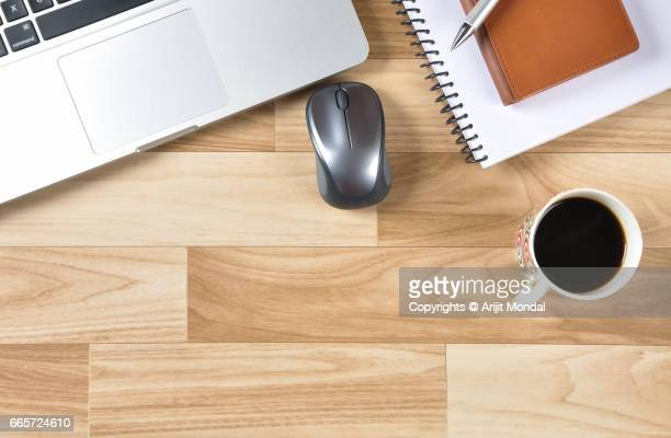 Retro Style Wooden Office Desk Top View with Copy Space, Laptop, Black Tea