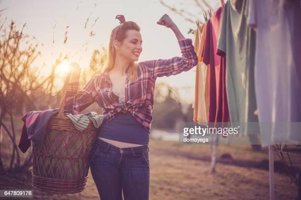 Retro styled girl doing housework