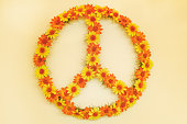 Retro styled image of a seventies flower power peace sign made out of flowers