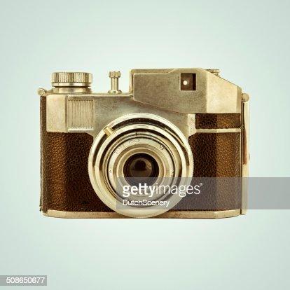 Retro styled image of a vintage photo camera : Stock Photo