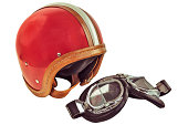 Retro styled image of an old motor helmet with goggles isolated on a white background