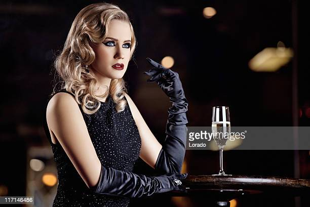 retro styled woman drinking champagne in bar