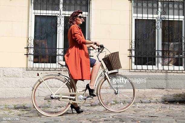 Retro styled woman riding a bike