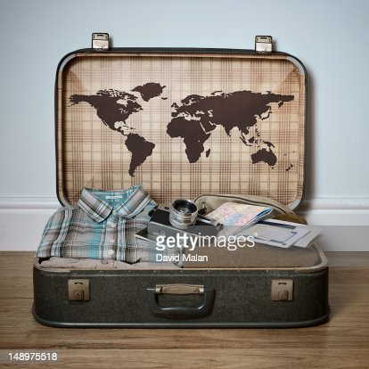 Retro suitcase with a world map on the inside lid : Stock Photo