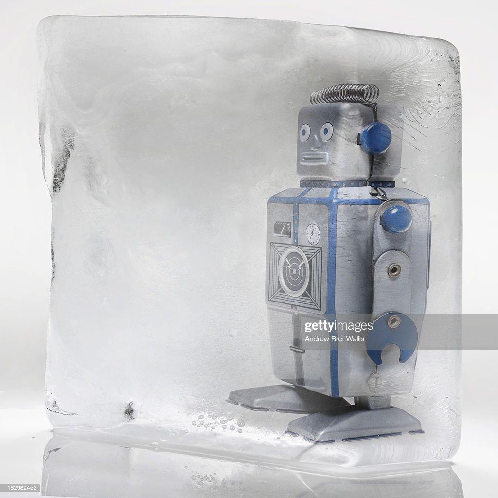 Retro tin robot frozen in an ice block