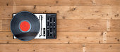 Top view retro record player header image on old wooden desk