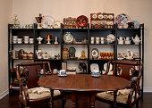 Retro / Vintage style tea room, vintage home interior. Tea time. Antique teacup, antique furniture. Afternoon tea at home.