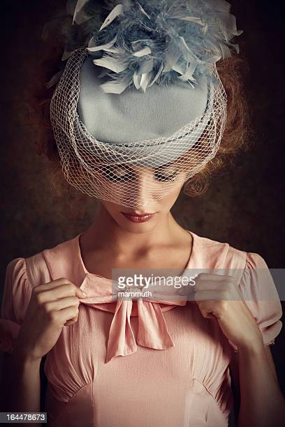 retro woman adjusting her clothes