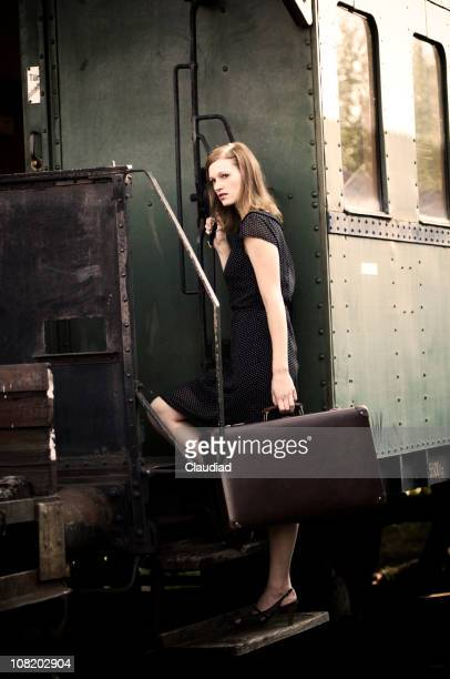 Retro Woman Boarding Train and Carrying Luggage