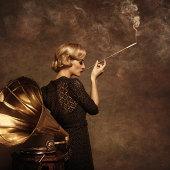 Retro woman listening to music and smoking cigarette