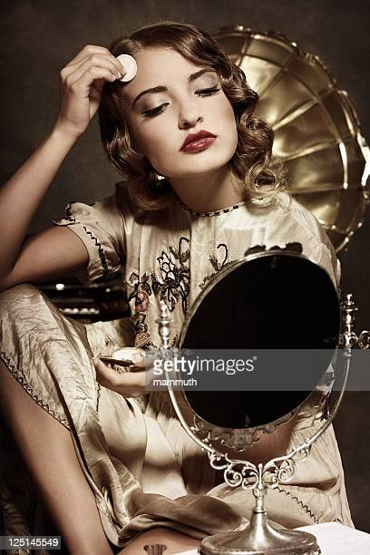 retro woman powdering face and listening to music