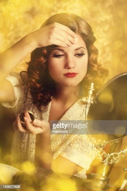 retro woman powdering face