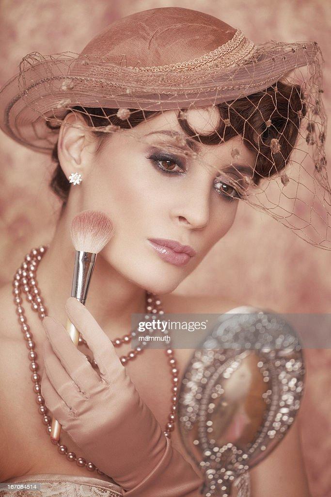 retro woman powdering face : Stock Photo
