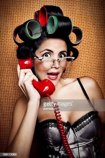 Retro Woman Sharing Juicy Gossip on Antique Red Telephone