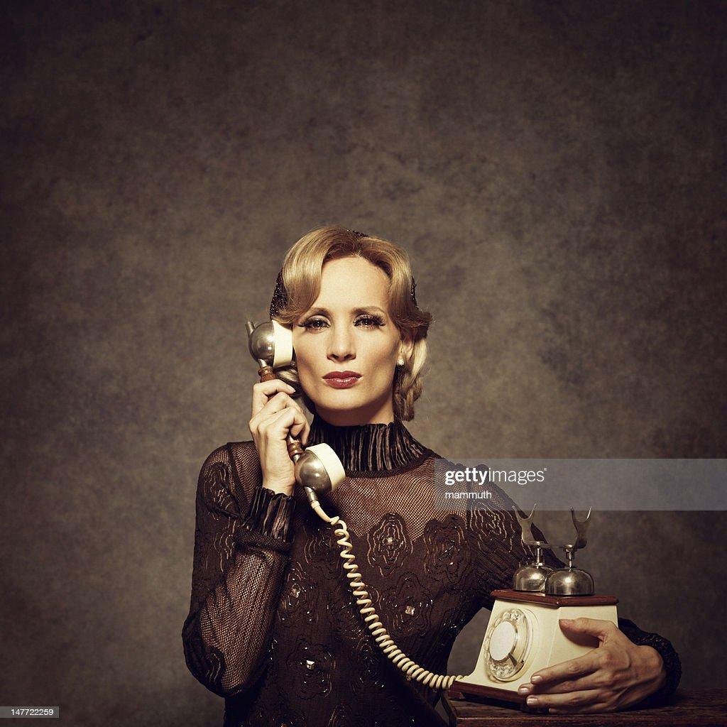 retro woman talking on the phone : Stock Photo