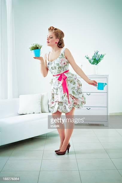 Retro woman watering flower
