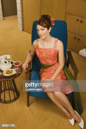 retro woman with cocktail and telephone stock foto getty images. Black Bedroom Furniture Sets. Home Design Ideas