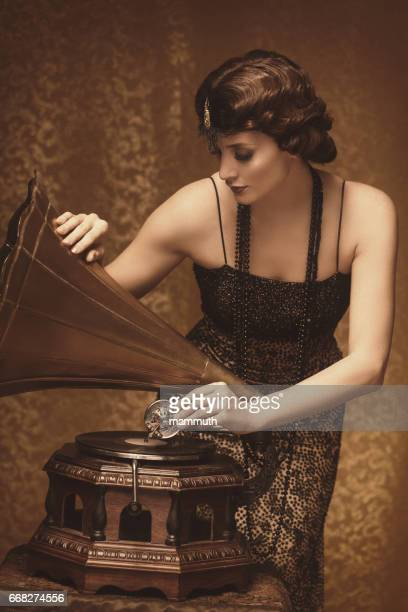 Retro woman with gramophone