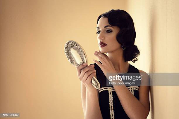 Retro woman with mirror