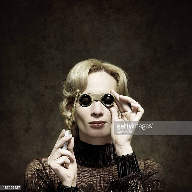 retro woman with opera glasses