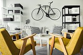 Black and white room and retro yellow chairs