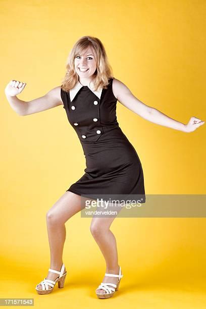 Retro-colored Photo Of A 1960s Dancer Twisting