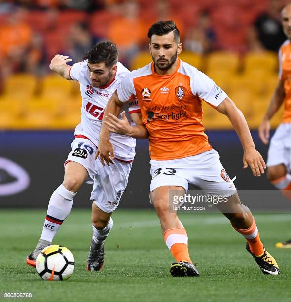 Retros Skapetis of the Roar contests the ball with Ben Garuccio of Adelaide United during the round two ALeague match between the Brisbane Roar and...