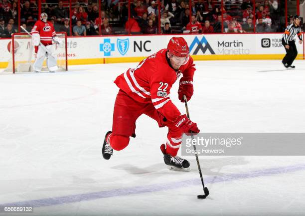 B rett Pesce of the Carolina Hurricanes skates with a puck on the ice during an NHL game against the New York Islanders on March 14 2017 at PNC Arena...