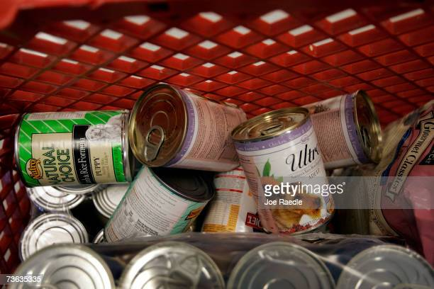 Returned cans of pet food fill a shopping car at Petco March 19 2007 in Miami Florida At least 10 pets have died after eating from among 40 brands of...