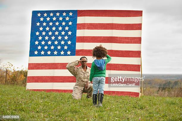 Returning Black soldier saluting daughter