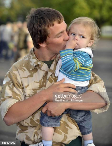 Returning Chepstow from Afghanistan with a kiss is Rifleman Mitchell Baldwin aged 18 from Lydney of the 1st Battalion The Rifles with his nephew...