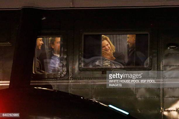 Returning from a trip in Las Vegas Nevada US President Barack Obama speaks with White House Director of Communications Jennifer Palmieri White House...