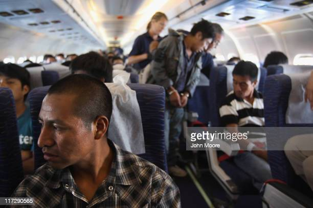 Returning Guatemalan immigrant Antonio Morales looks out the window before landing on a deportation flight from Mesa Arizona on June 24 2011 in...