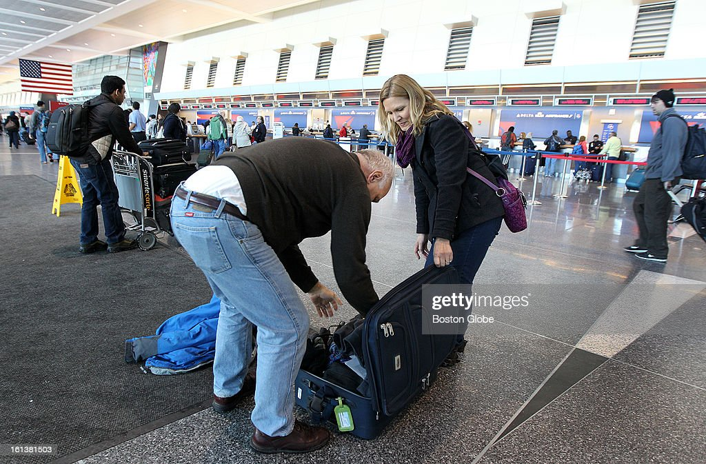 Returning to Minnesota, Syd, left, and Cinda Stephan were in town selling commercial snow blowers at a convention. Logan Airport is reopened for the first full day, on Sunday, February 10, 2013, after the blizzard.