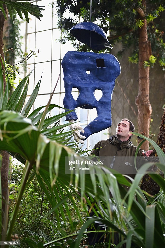 Reuben Guatelli looks at an installation by sculptor Jesse Wine inside the Victorian Palm House in the Royal Botanic Garden on February 12, 2016 in Edinburgh, Scotland. Works by twenty two of the artists in British Art Show 8 will be exhibited at the Scottish National Gallery of Modern Art. The selection reflects the huge diversity of media used by artists working today, and features painting, sculpture, printmaking, textiles, film and video, large-scale installation and ceramics. Artists include the 2013 Turner Prize-winner Laure Prouvost, the acclaimed Scottish filmmaker Rachel Maclean, the celebrated artist Linder, who started her career at the centre of the Seventies punk scene in Manchester, and Turner Prize-nominees Lynette Yiadom-Boakye and Ciara Phillips.