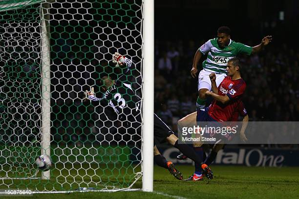 Reuben Reid of Yeovil Town rises above Gabriel Tamas of West Bromwich Albion to head the equalising goal past Boaz Myhill during the Capital One Cup...