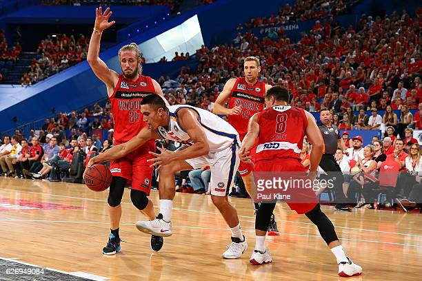 Reuben TeRangi of the Bullets gets fouled by Jesse Wagstaff of the Wildcats during the round nine NBL match between the Perth Wildcats and the...