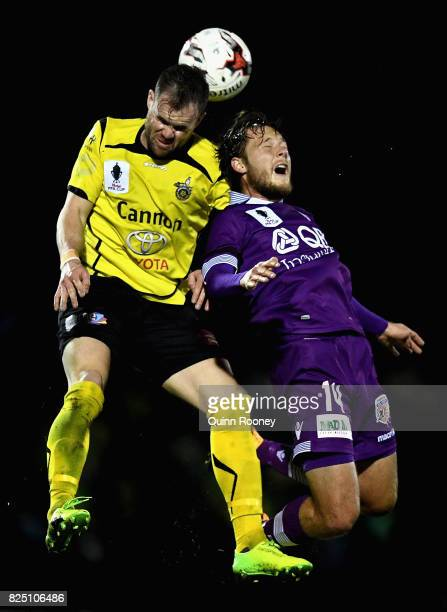 Reuben Way of United and Chris Harold of Glory compete to head the ball during the FFA Cup round of 32 match between Heidelberg United FC and Perth...