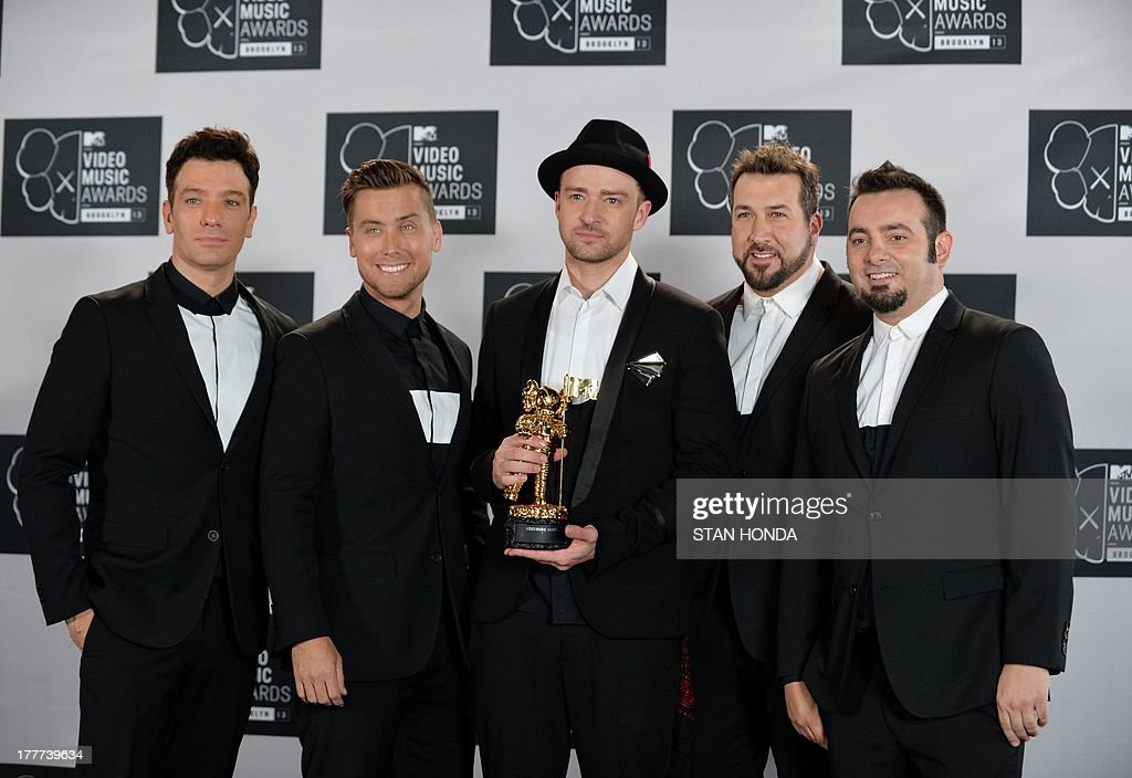 A reunited 'N Sync including Justin Timberlake (C), JC Chasez (L), Lance Bass (2nd L), Joey Fatone (2nd R), and Chris Kirkpatrick (R) at the MTV Video Music Awards August 25, 2013 at the Barclays Center in New York. AFP PHOTO/Stan HONDA