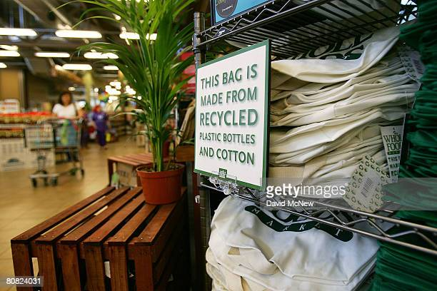 Reusable grocery bags made from recycled plastic bottles and cotton are sold at a Whole Foods Market natural and organic foods store which is ending...