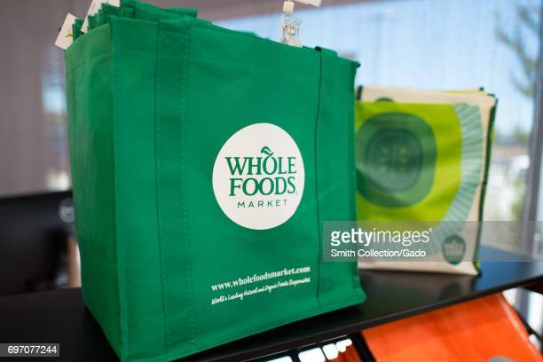 Reusable shopping bag with logo at Whole Foods Market grocery store in Dublin California June 16 2017 On June 16 Amazoncom announced that it would...