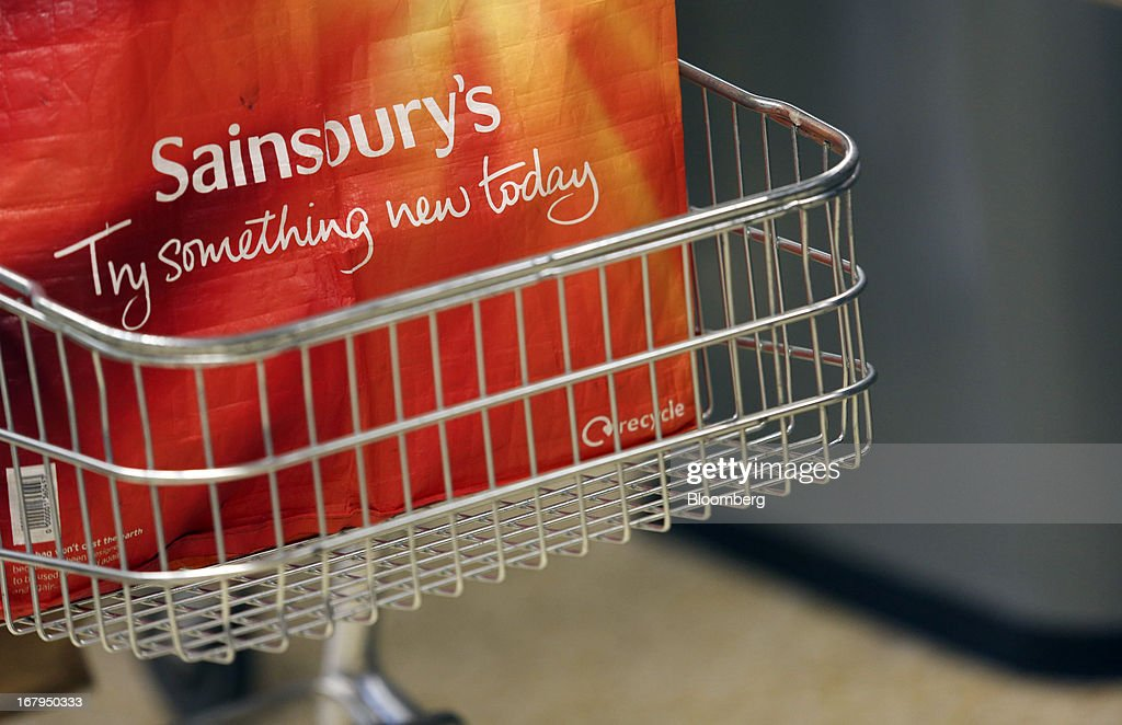 A re-useable shopping bag sits in a cart at a checkout desk inside a Sainsbury's supermarket store, operated by J Sainsbury Plc, in Godalming, U.K., on Thursday, May 2, 2013. J Sainsbury Plc, the U.K.'s third-largest supermarket chain, will report full year results on May 8. Photographer: Chris Ratcliffe/Bloomberg via Getty Images
