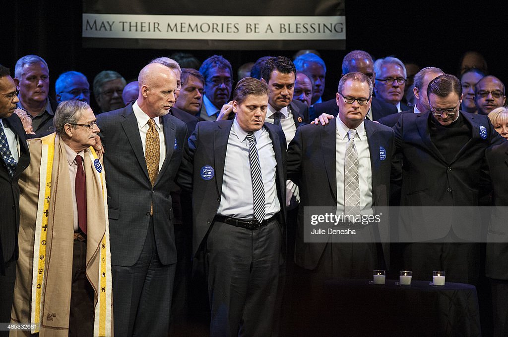 Rev. Adam Hamilton (2nd R) and Father Stephen Cook (R) join clergy of different faiths gathered onstage to sing 'O se Shalom' in honor of victims of Sunday's shootings on April 17, 2014 at the Jewish Community Center of Greater Kansas City, in Overland Park, Kansas. White supremacist Frazier Glenn Cross is in custody, charged with murder in the killing of two people outside the center and a third victim at a nearby Jewish retirement home on April 13.