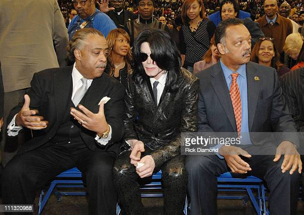 Rev Al Sharpton Michael Jackson and Rev Jesse Jackson pay their respects to the late James Brown who is lying in repose at the James Brown Arena in...