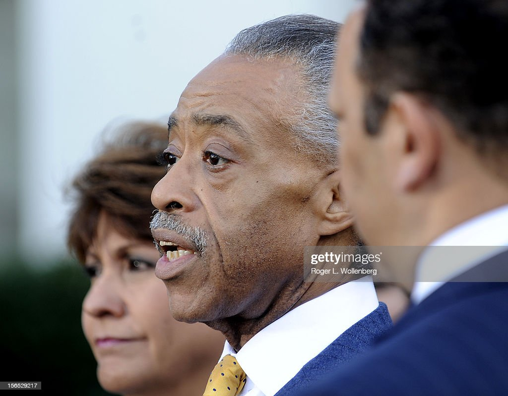 Rev. Al Sharpton (C) speaks to the media as Janet Murguia (L), President and CEO, National Council of La Raza (NCLR) (L) and National Urban League President Marc Morial listen after leaders of civic organizations and other outside groups met with U.S. President Barack Obama at the White House on November 16, 2012 in Washington, DC. The meeting focused on economic concerns, taxes and health care.