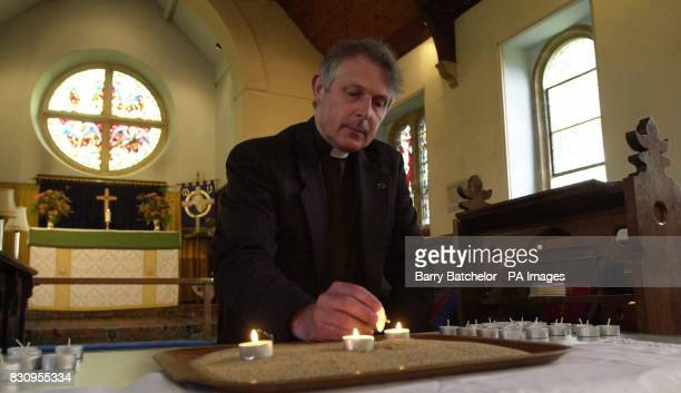 Rev Alistair Wallace lights three candles at St Peter's Church in Horton Somerset the tiny village where a young girl and two adults died as a result...