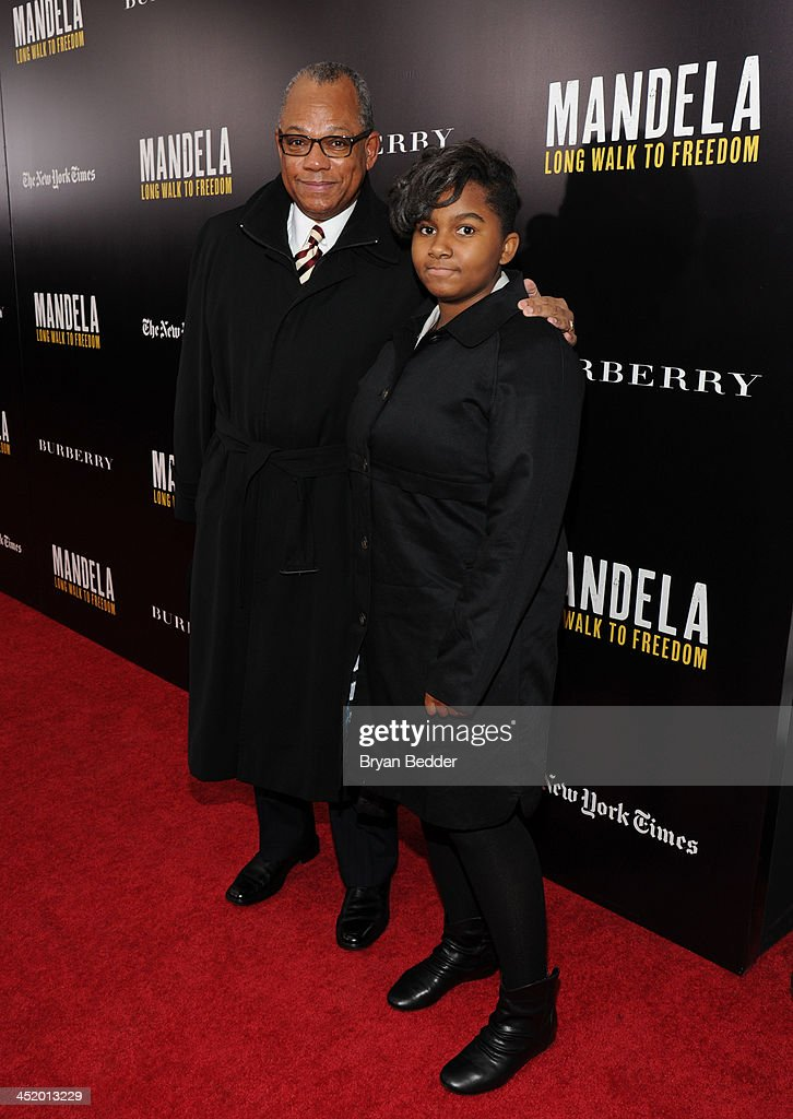 Rev. Calvin O. Butts III and guest attend U2 And Anna Wintour Host A Special Screening Of Mandela: Long Walk To Freedom, In Partnership With Burberry And The New York Times at Ziegfeld Theatre on November 25, 2013 in New York City.